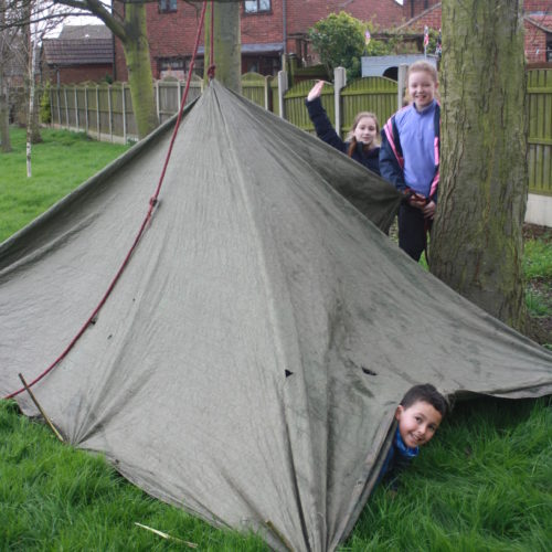 Tepee Design with tarp suspended from fixed hanging rope